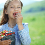 Girl eating strawberries
