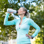 Woman drinking water bottle