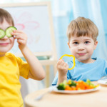Kids eating veggies
