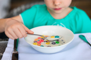 Kid eating sugary cereal